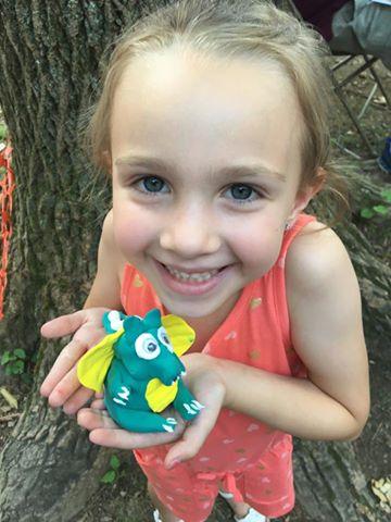 KidzArt Child Holding Model Magic Dinosaur